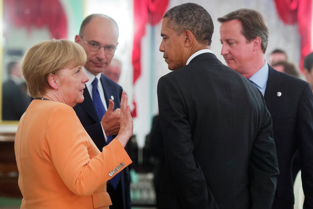 Angela Merkel deep in discussion with Enrico Letta, Barack Obama and David Cameron (left to right).