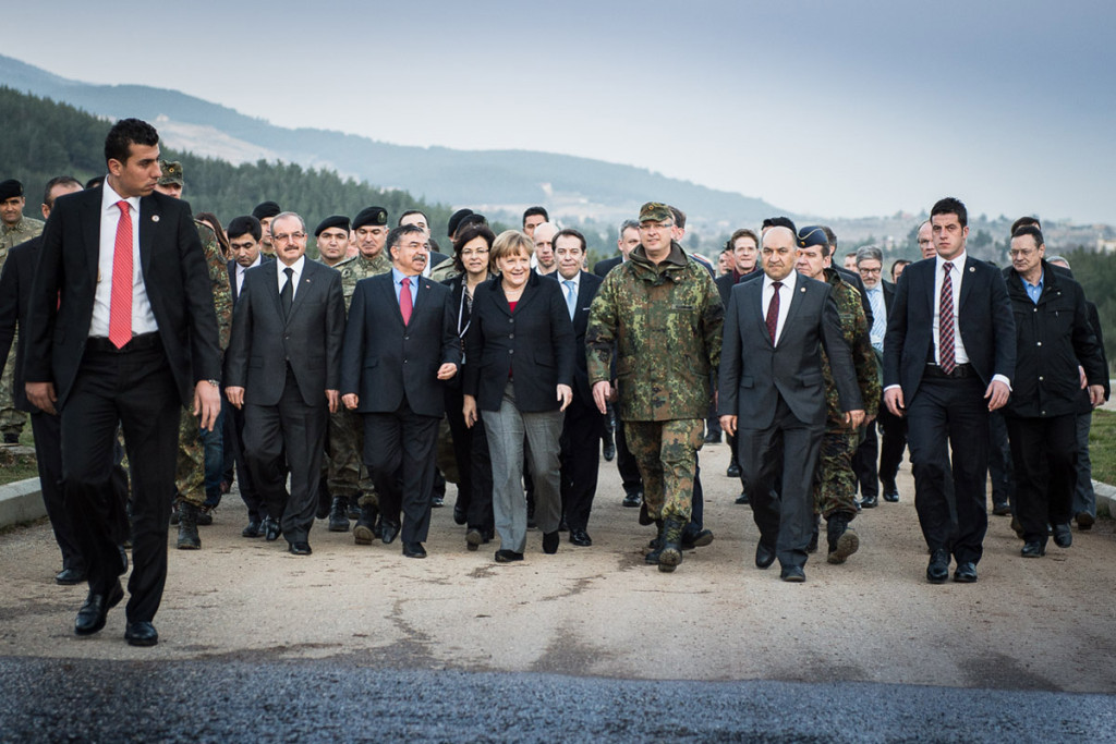 Chancellor Angela Merkel is accompanied by the Turkish Defence Minister Ismet Yilmaz and Colonel Ellerman as she goes to inspect a Patriot System.