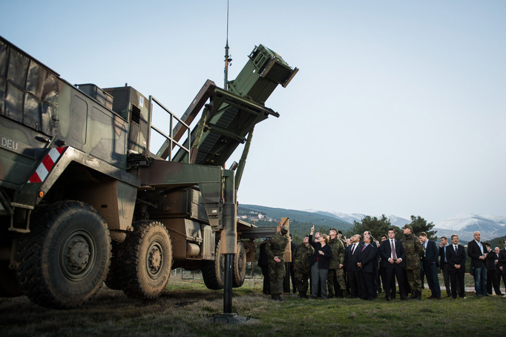 Chancellor Angela Merkel beside a Patriot System installed for inspection.