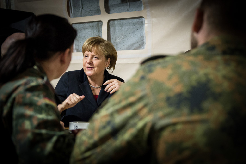 Chancellor Angela Merkel talks to German soldiers from the Patriot Unit stationed in Kahramanmaras.