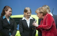 Chancellor Angela Merkel talks to two young women