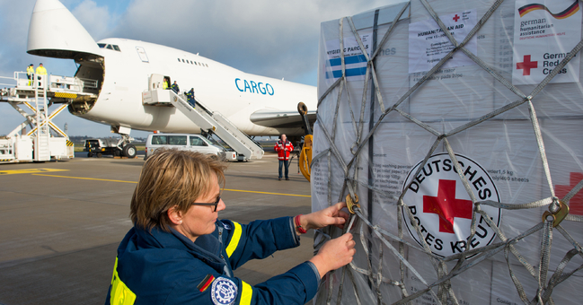 Georgia Pfleiderer from THW checks supplies destined for typhoon victims in the Philippines at Schönefeld Airport