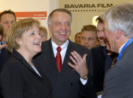 Chancellor Angela Merkel and minister of State for Culture Bernd Neumann talking to representatives of the film industry