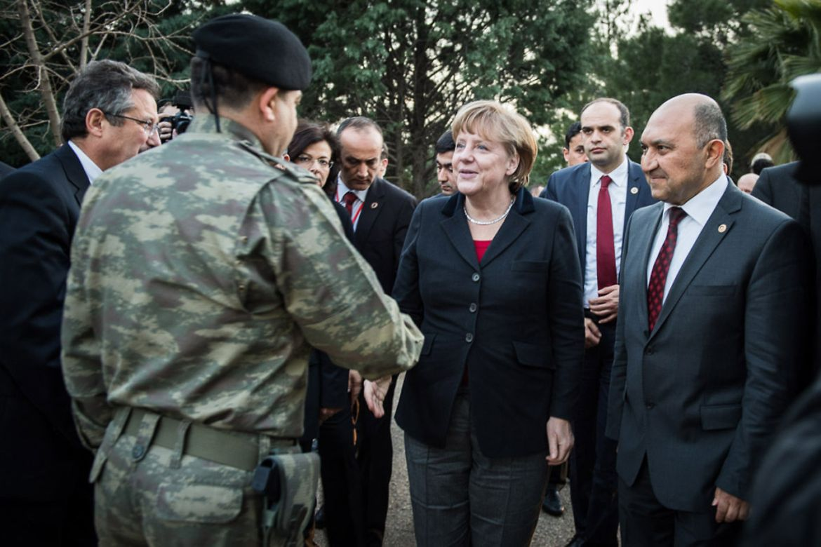 Chancellor Angela Merkel is greeted by the Turkish commanding officer Colonel Kazaz at the Kahramanmaras Base.